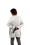 Smart woman put the gun behind her back. Isolated against white Royalty Free Stock Photo