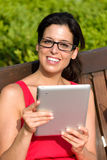 Smart woman reading on table in park Stock Photography