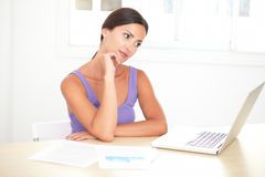 Smart woman sitting and working in her room Royalty Free Stock Photography
