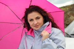 Smart woman with umbrella outdoors Royalty Free Stock Photos