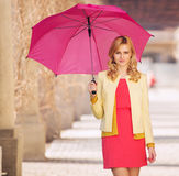 Smart woman waling with umbrella Royalty Free Stock Image