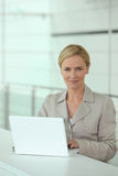 Smart woman working hard Stock Images