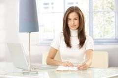 Smart woman working at home Stock Photo