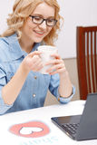 Smart woman working with a laptop Stock Photography
