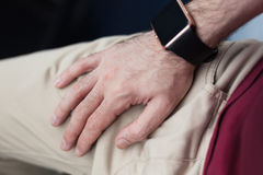 Smart wrist watch on male hand Stock Photos