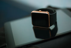 Smart wrist watch and tablet pc Stock Images