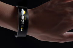 Smart wristband with weather icon. Royalty Free Stock Images