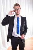 Smart young business man in suit and tie on the phone Royalty Free Stock Photo