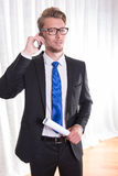 Smart young business man in suit and tie on the phone Stock Photos