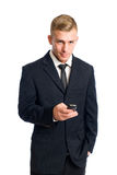 Smart young businessman with his cellphone. Royalty Free Stock Images