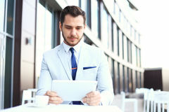 A smart young businessman using tablet computer Stock Photography