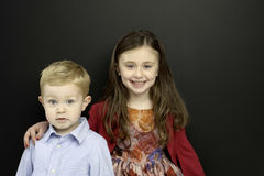 Smart young Children stood infront of a blackboard Royalty Free Stock Photography