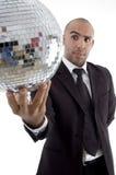 Smart young executive looking at disco ball Stock Photo