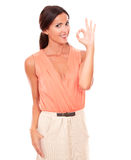 Smart young female gesturing a great job Royalty Free Stock Image