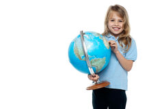 Smart young girl showing her country on a globe Stock Photo