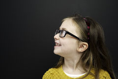 Smart young girl stood infront of a blackboard Stock Image