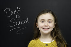 Smart young girl stood infront of a blackboard Royalty Free Stock Photos