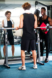 Smart young guy lifting barbells in gym Royalty Free Stock Images