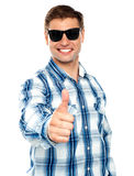 Smart young guy showing thumbs up Royalty Free Stock Images