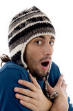 Smart young guy in winter cap shivering from cold Stock Photography
