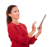 Smart young lady using her tablet pc Royalty Free Stock Images