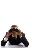 Smart young lawyer using a pair of binoculars Stock Photography