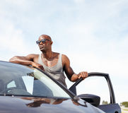 Smart young man with a car Stock Photo