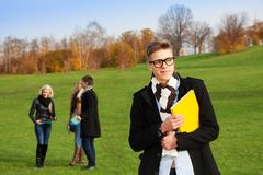 Smart young man in college park Royalty Free Stock Photos