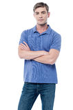 Smart young man with crossed arms Royalty Free Stock Image