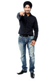 Smart young man pointing towards you Stock Images
