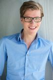 Smart young man smiling with glasses Stock Photos
