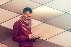 Smart young man works on tablet computer outdoors in urban public space royalty free stock photos