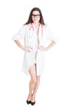 Smart young medic posing in medical coat. On white background stock image