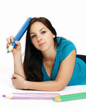 Smart young woman with big pencil Stock Photo