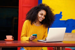 Smart young woman using laptop at outdoor coffee shop Royalty Free Stock Photos