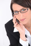 Smart young woman wearing glasses Stock Photo