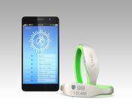 Smarta armband och smartphone Arkivbilder