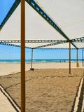 Canopy from the sun on a sandy beach royalty free stock images