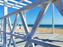 White planks on the sand royalty free stock photos