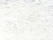 White uneven texture. background of sawdust stock image