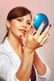 Smartens up with compact mirror Stock Photo