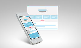 Smarthphone με το σχέδιο ιστοσελίδας στην οθόνη Στοκ Φωτογραφίες