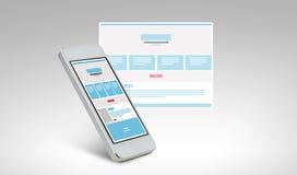 Smarthphone med webbsidadesign på skärmen Arkivfoton