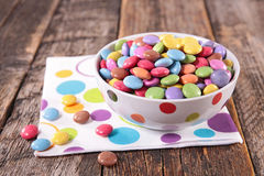 Smarties. Bowl of smarties on wood background Stock Photography