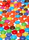 Smarties colorés Photos stock