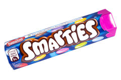 Smarties Sweets Tube. LONDON, UK - OCTOBER 13TH 2016: An unopened Smarties chocolate sweets tube manufactured by Nestle, pictured over a plain white background Stock Photos