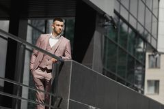 Businessman in city. Modern businessman. Confident young man in full suit standing outdoors Royalty Free Stock Photo