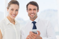 Smartly dressed colleagues with a mobile phone Stock Photography
