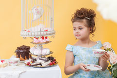 Smartly dressed little lady drinking tea Stock Photography