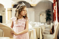 Smartly dressed little lady posing in restaurant Royalty Free Stock Image